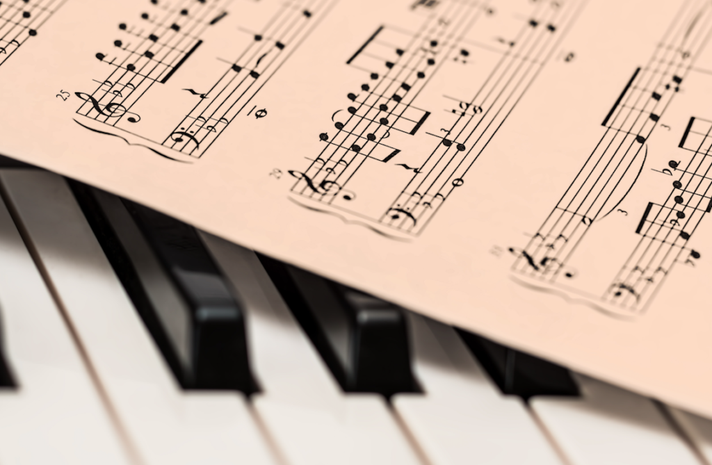 -Listening to a piece of music while following the sheet music can also help us to develop this skill